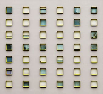 Assorted windows on gray wall