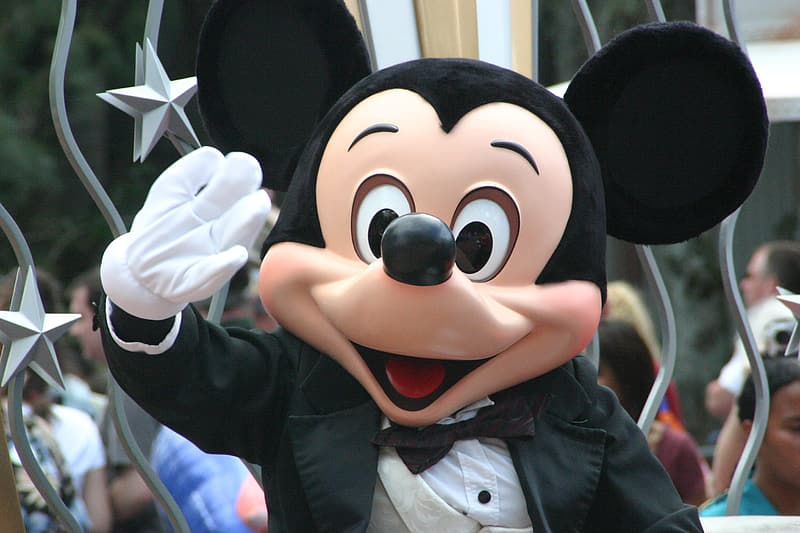 Mickey Mouse waves his hand