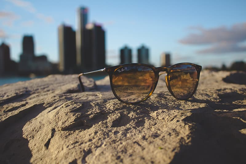 Ray-Ban sunglasses on rock