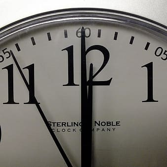 White and black Sterling Noble analog clock