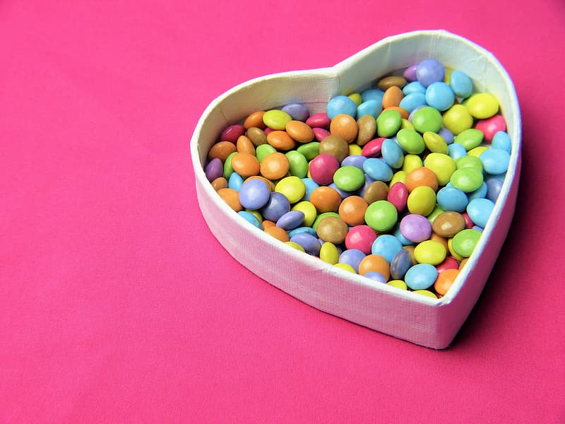 Assorted-color candies in heart-shaped box