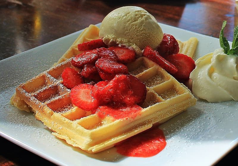 Waffle with strawberry and ice cream