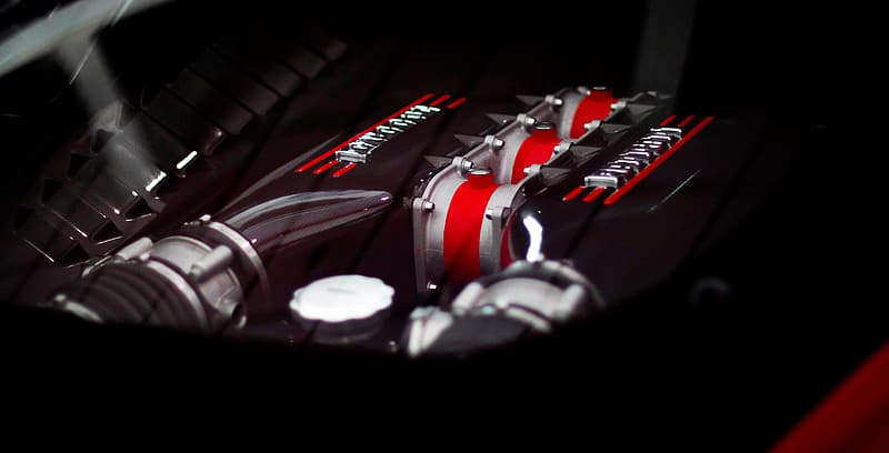 Selective focus photo of a vehicle engine