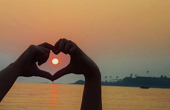 Silhouette of hand heart symbol