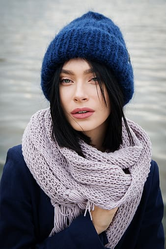 Woman wearing blue knit hat