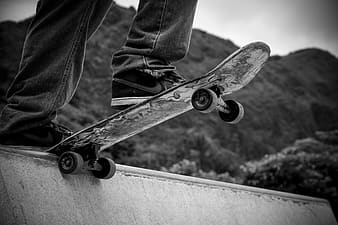 Greyscale photography of person skateboarding