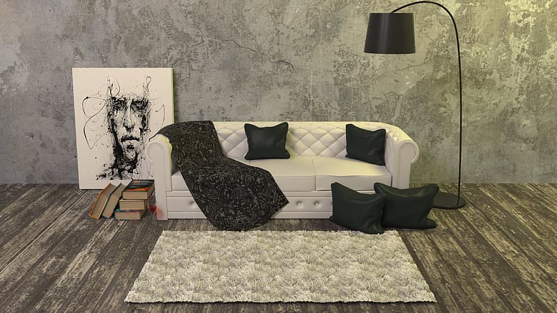 White leather 3-seat sofa with four black pillows beside the black floor lamp