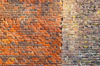 Cleaned orange brick wall on the left side and dirt brown brick wall on right side