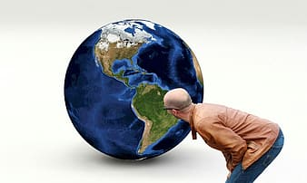 Person looking at planet earth