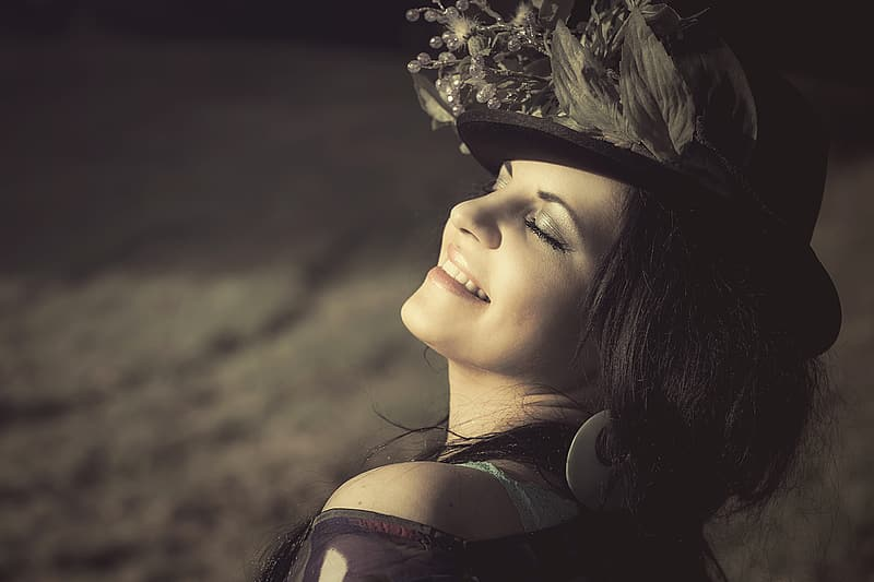 Woman with black and gray flower accent hat close-up photography
