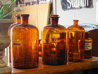 Brown glass bottles on wooden table
