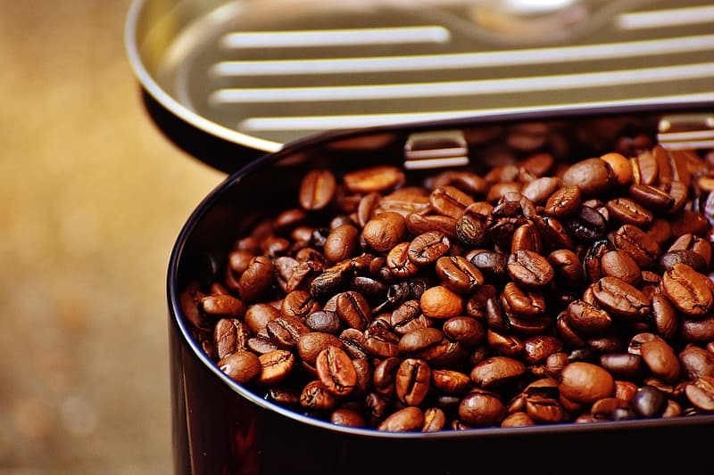 Coffee beans on oval black metal container