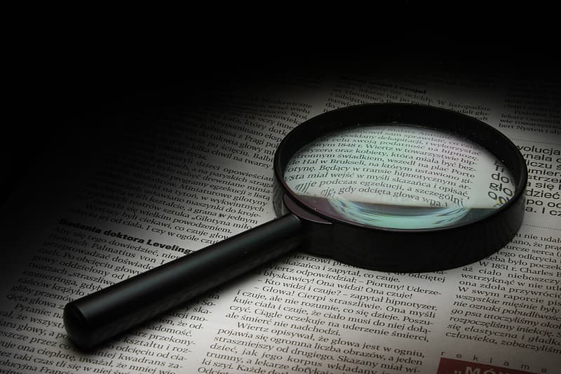 Round magnifying glass with black frame