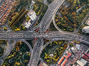 Vehicles traveling on road aerial photo
