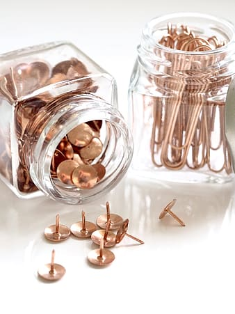 Clear glass jar with brown round coins