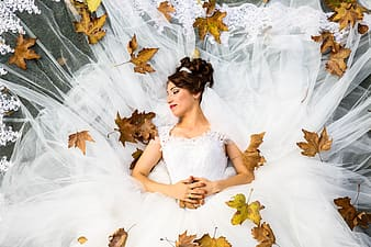 Woman wearing white wedding gown posing for photo