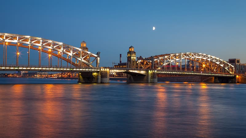 Brown and white bridge under blue sky during night time