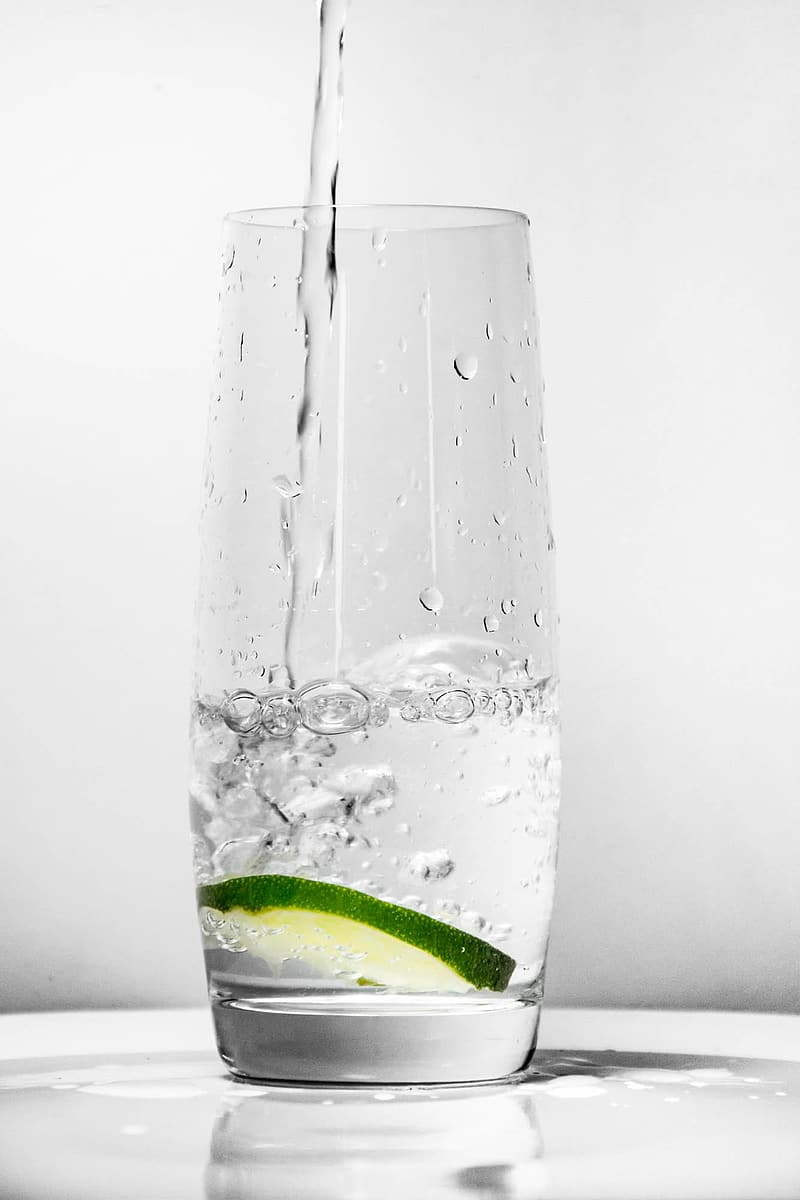 Clear glass cup with drop of water
