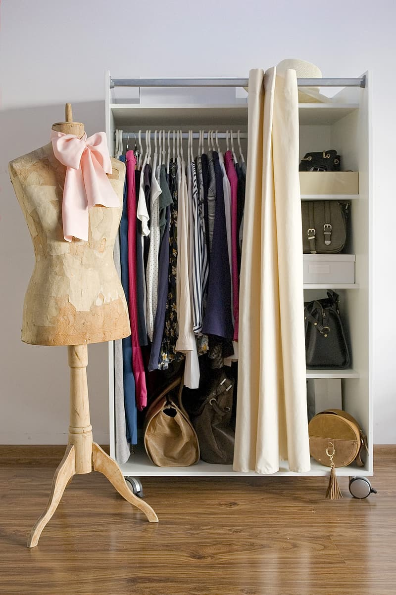 Brown and beige dress hanged on brown wooden clothes hanger