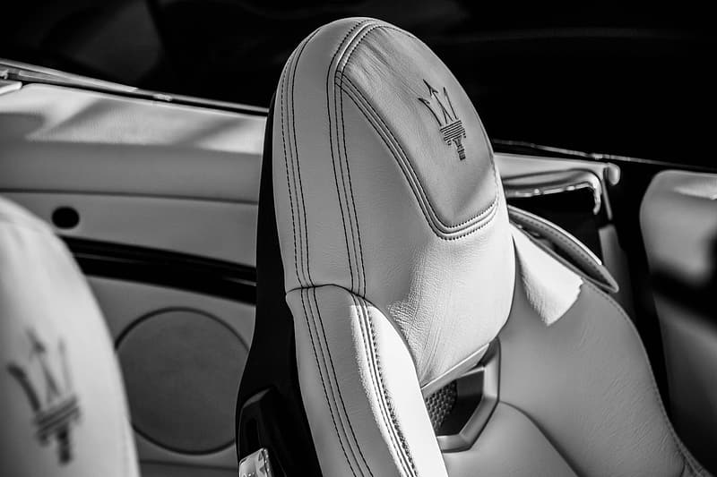 Grayscale photo of car seat