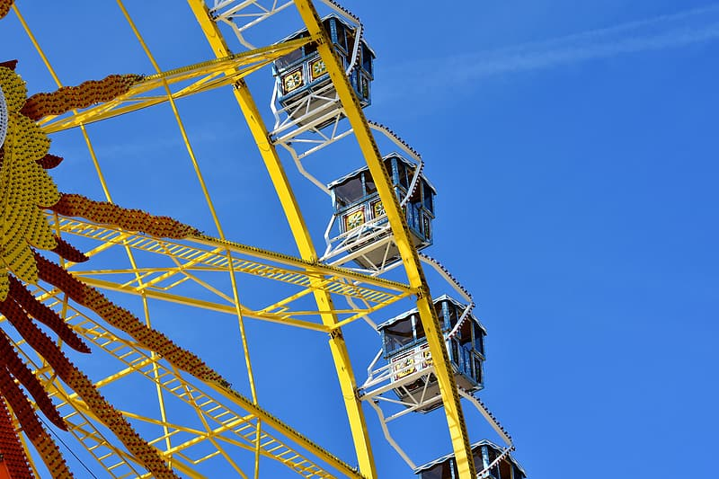 Yellow metal tower under blue sky during daytime