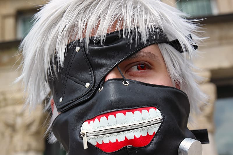 Person wearing black and white mask