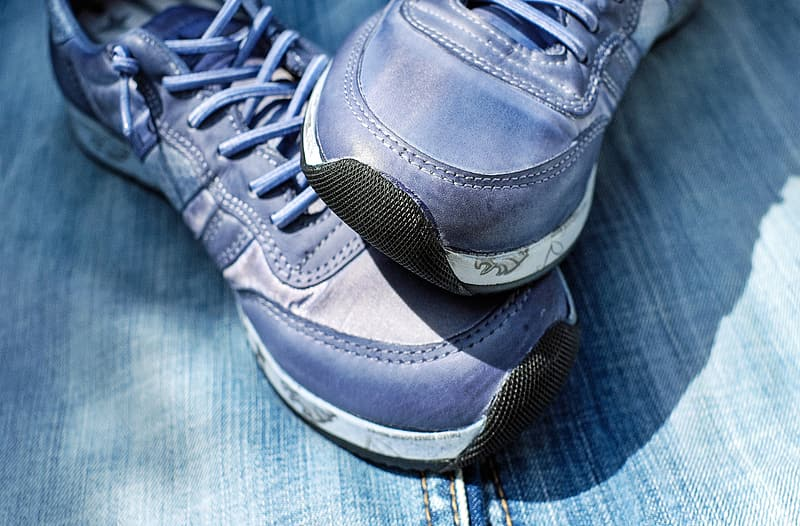 Close-up photography of blue running shoes