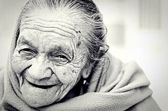 Greyscale photo of woman smiling