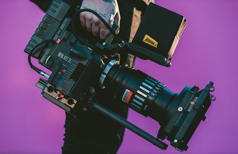 Person holding professional camera