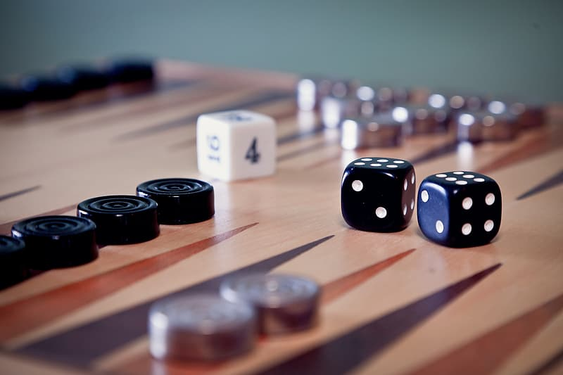 White and black dices on brown wooden table