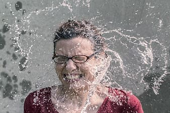 Woman splashed by water
