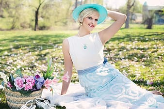 Woman wearing blue hat and white dress