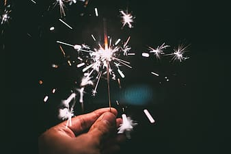 Person holding white and green fireworks