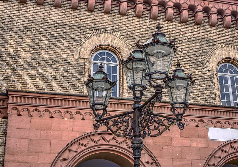Black sconce lamp on brown brick wall