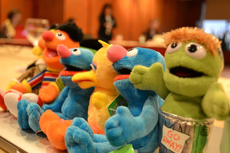 Sesame Street characters plush toys on table