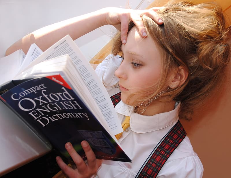 Girl reading Compact Oxford English Dictionary