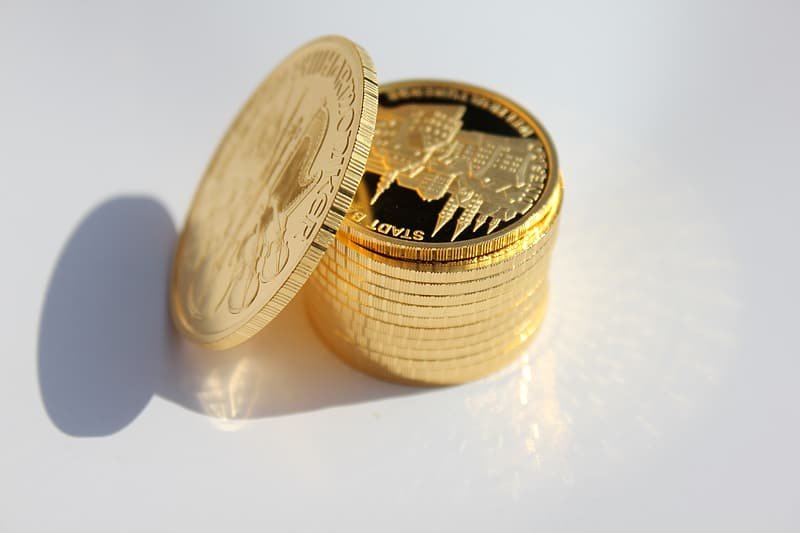 Stack of round gold-colored coins
