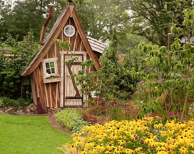 Brown wooden cabin near green leafed tree