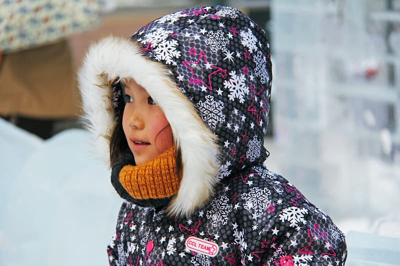 Girl wearing black and red parka coat