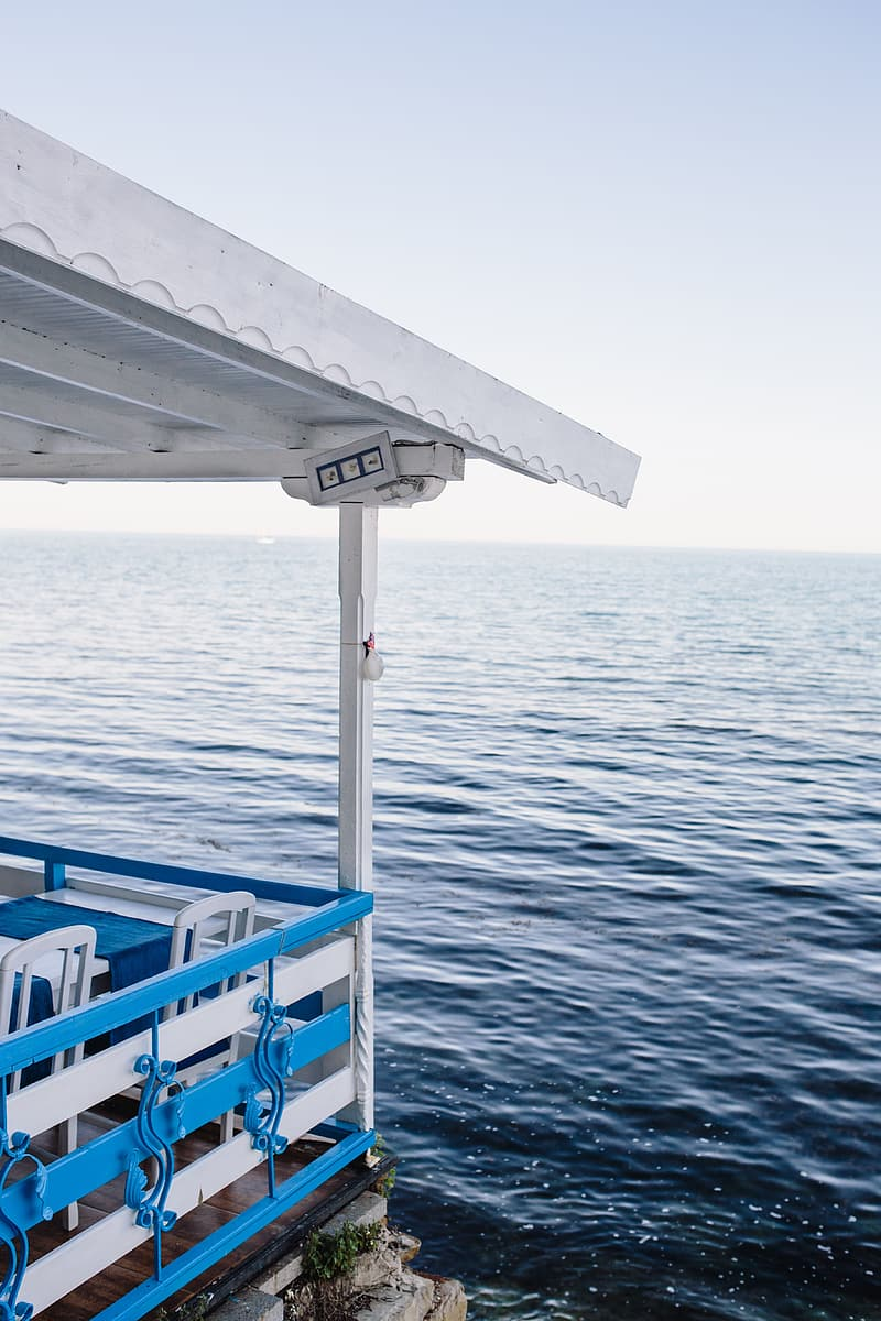 Blue and white boat on sea during daytime