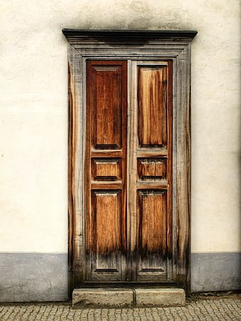Brown and grahy wooden door