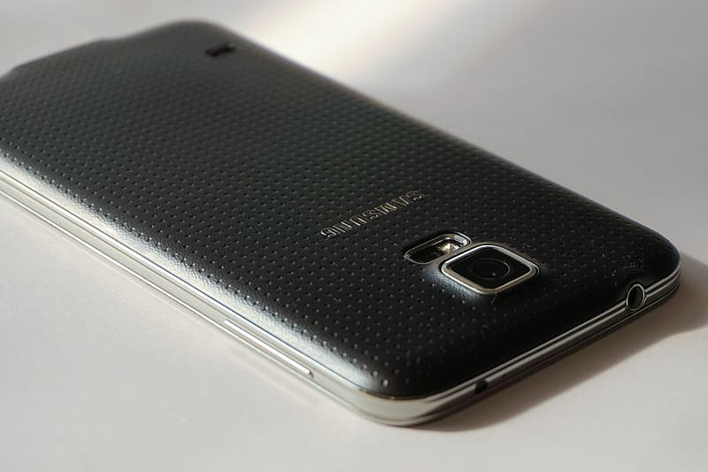 Black Samsung Android smartphone on white surface