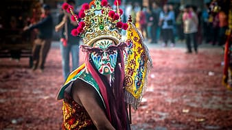 Person wearing festival mask