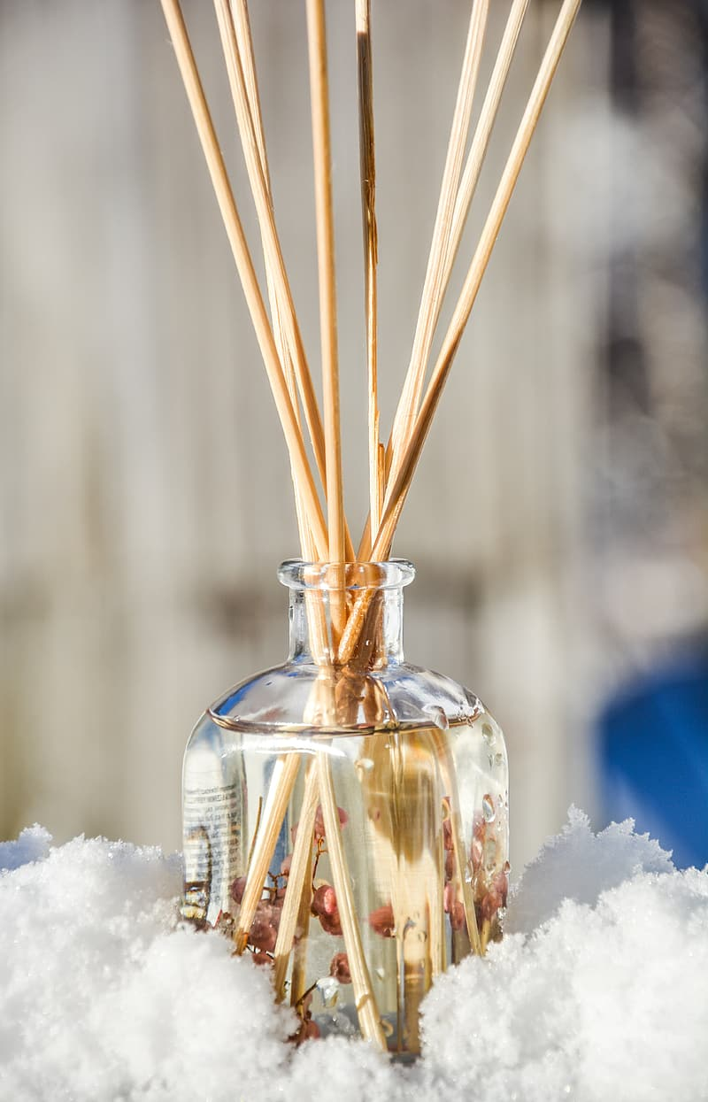 Incense sticks on clear glass container