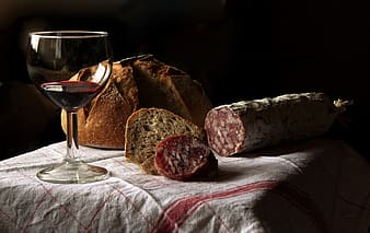Wine glass and bread on table