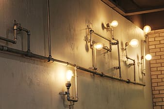 Gray metal pipe-themed wall lamp inside room