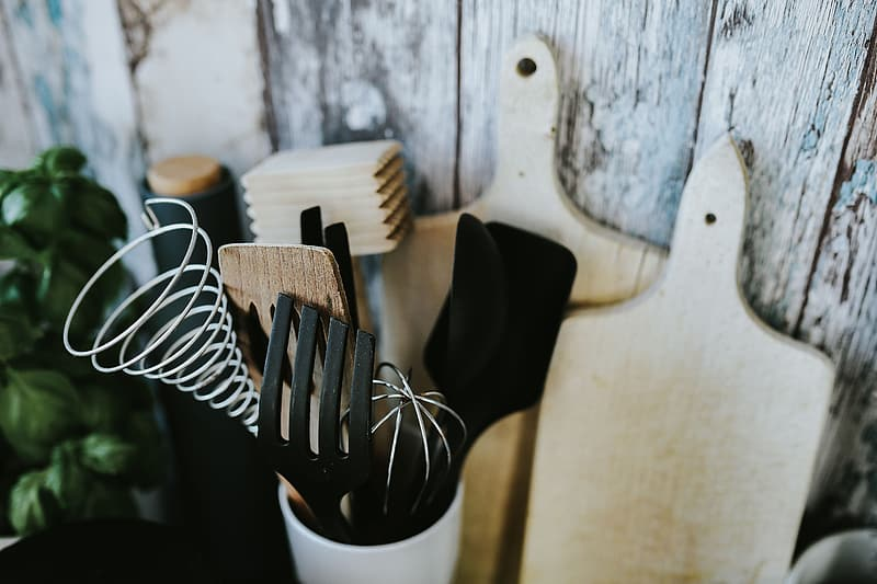 Kitchen utensils and cans by the wall