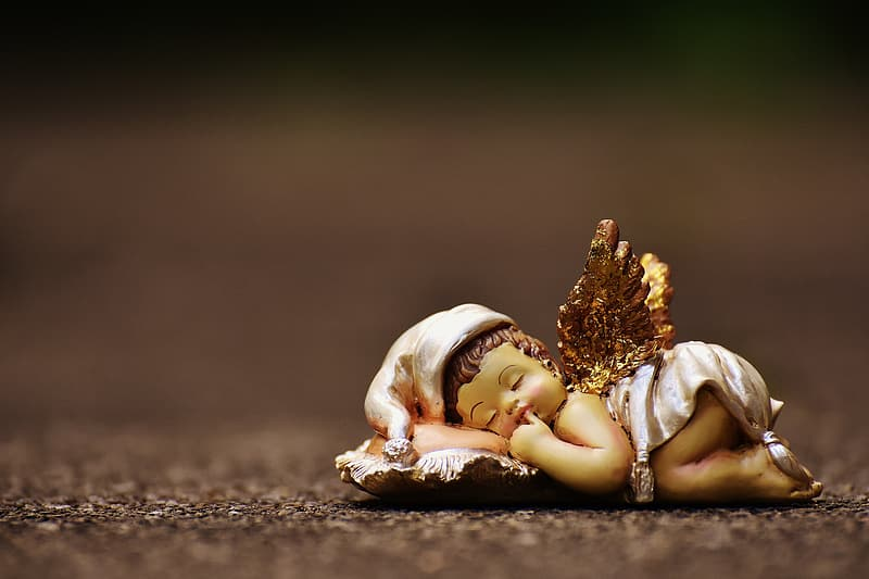 Macro photography of baby angel ceramic figurine