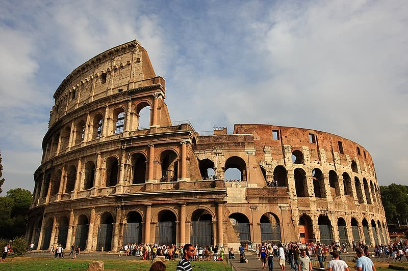 People outside Colosseum, Italy during daytime