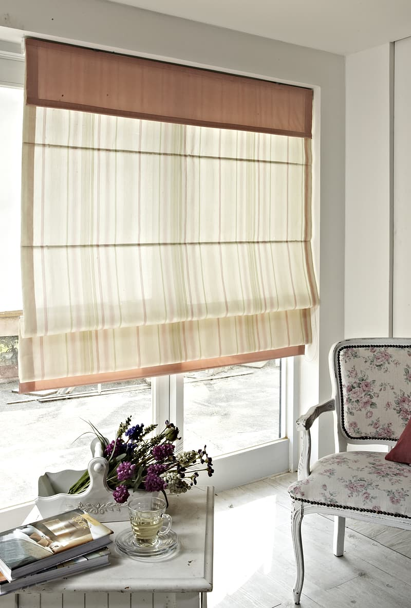 Room with brown and white window curtain brown wooden chair
